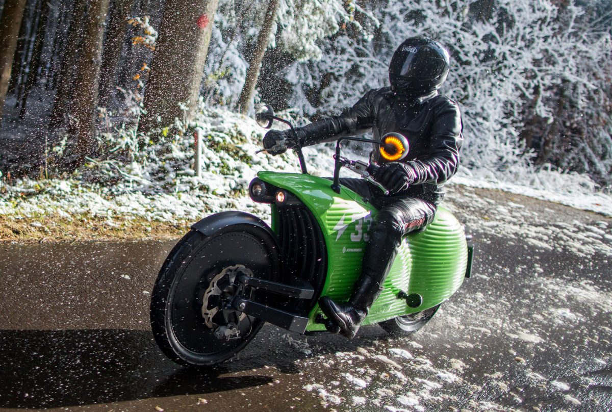 A Johammer electric motorcycle rides on a road near the Johammer e-mobility GmbH electric motorbike factory as snow falls in Bad Leonfelden, Austria, on Tuesday, Nov. 8, 2016. Photographer: Lisi Niesner/Bloomberg